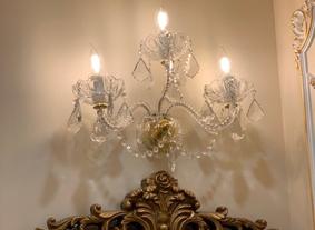 Crystal wall light upon a design mirror, Los Angeles, USA